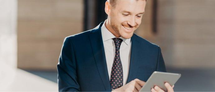 happy-prosperous-businessman-in-formal-wear-makes-money-transaction-via-touch-pad-has-glad-expression_t20_Ll0owo (1)